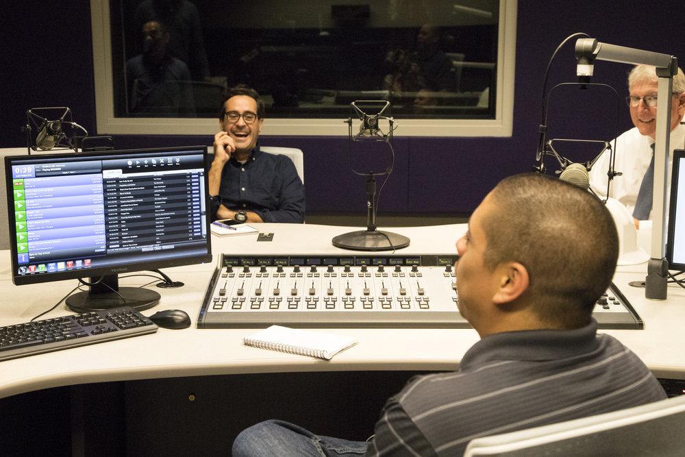 On September 14, 2017 Ben Howell (left), Robert Tabarango, and Greg Brown discuss the new radio studio in the Center for Media and Design campus in Santa Monica, Calif. (Jazz Shademan)