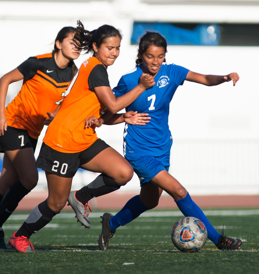 Santa Monica College Corsair Josseline Espinoza (7) (R) fights for control of the ball against Ventura College Pirate Carolina Apodaca Morales (20) (Center) on Tuesday September 26, 2017 on the Corsair Field at Santa Monica College in Santa Monica, California. The Corsairs win the game 2-1. (Josue Martinez)