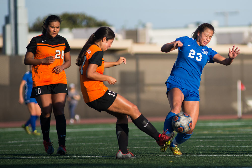 Santa Monica College Corsair Daysi Serrano (23) (R) attempts to block a pass from Ventura College Pirate Eleni Borjon (17) (CTR) on Tuesday September 26, 2017 on the Corsair Field at Santa Monica College in Santa Monica, California. The Corsairs win the game 2-1. (Josue Martinez)