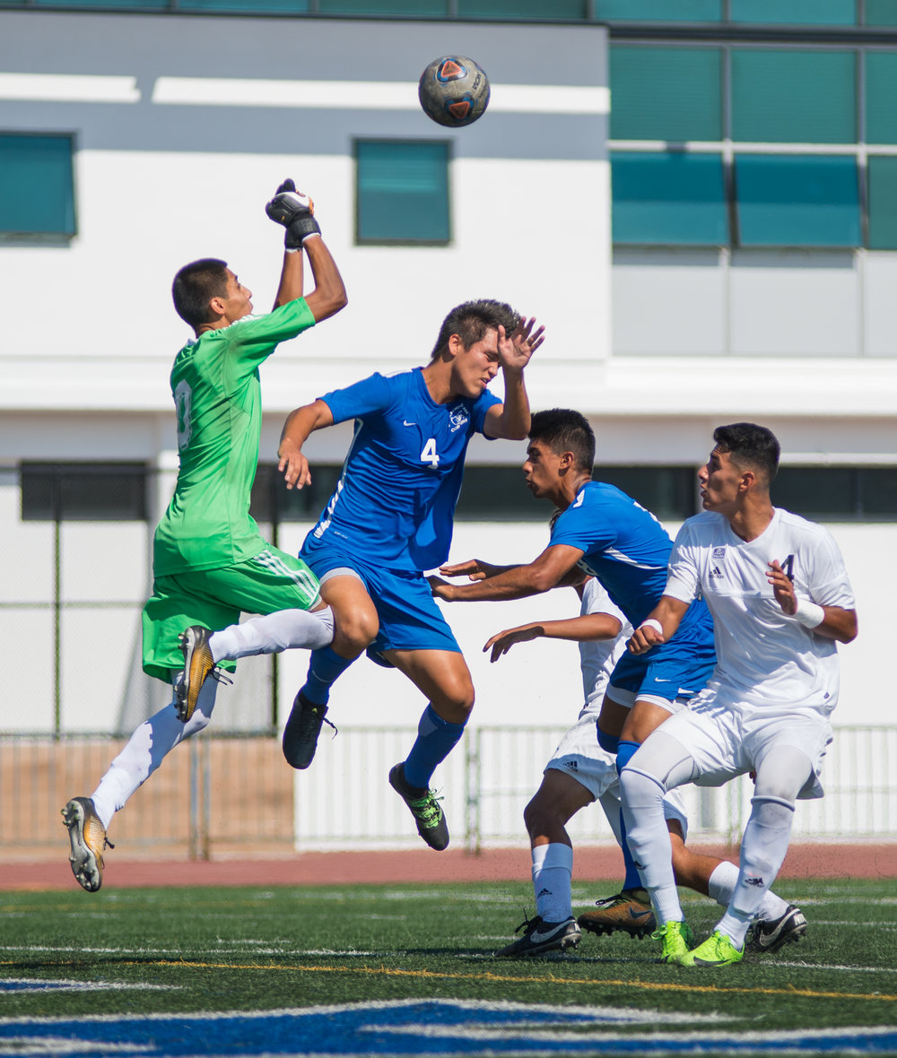 Santa Monica College Corsair Cesar Oliva (4) (CTR) goes up for a header against Citrus College Owl Jorge Quinones (0) (L) on Tuesday September 26, 2017 on the Corsair Field at Santa Monica College in Santa Monica, California. The Corsairs tied the game 1-1. (Josue Martinez)