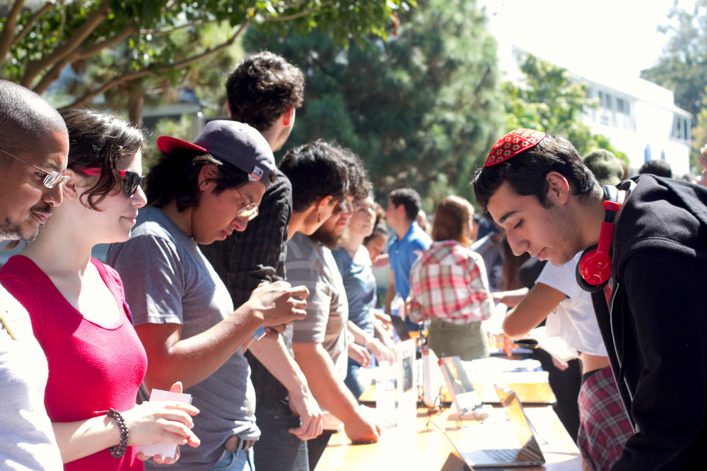 (L to R) Co-President of the club Turning Point USA Liberty Fuchs informing student Faraz Moallemi about the stand the club takes during Club Awareness Day at Santa Monica College in Santa Monica, Calif., September 28, 2017. (Photo By: Rips Avetisyan/Corsair Staff)