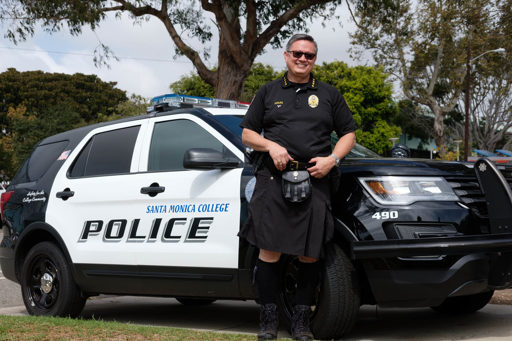 Chief of Police, Johnnie Adams poses for a portrait while wearing a 5.11 tactical kilt. Adams promised to wear the kilt if $750 was raised for Breast Cancer Awareness. Photo by: Jayrol San Jose