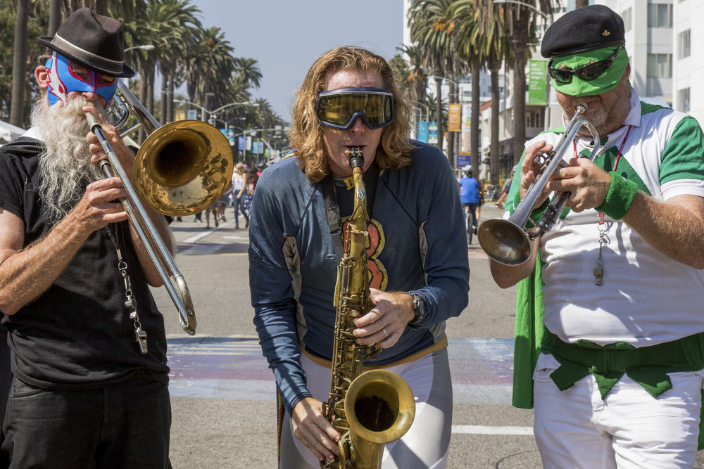 Members of the Superbroke Brass and Tin and Strings Marching Band Ensemble perform on Ocean Avenue in Downtown Santa Monica as part of the City of Santa Monica's Open Streets Festival (COAST) which took place on October 1, 2017 (Photo By: Zane Meyer-Thornton)