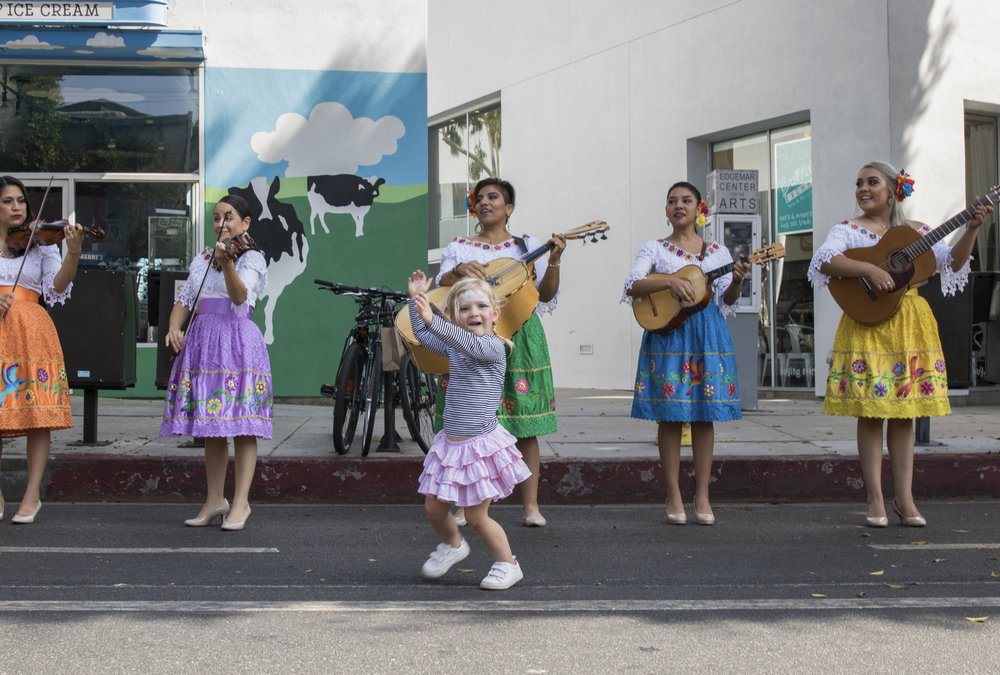 Sophia Nordby (center) dances along to the performance of Las Colibrí, an all-string female mariachi band who performed on Main Street during the City of Santa Monica's Open Streets Festival which took place on October 1, 2017. Photo by: Zane Meyer-Thornton