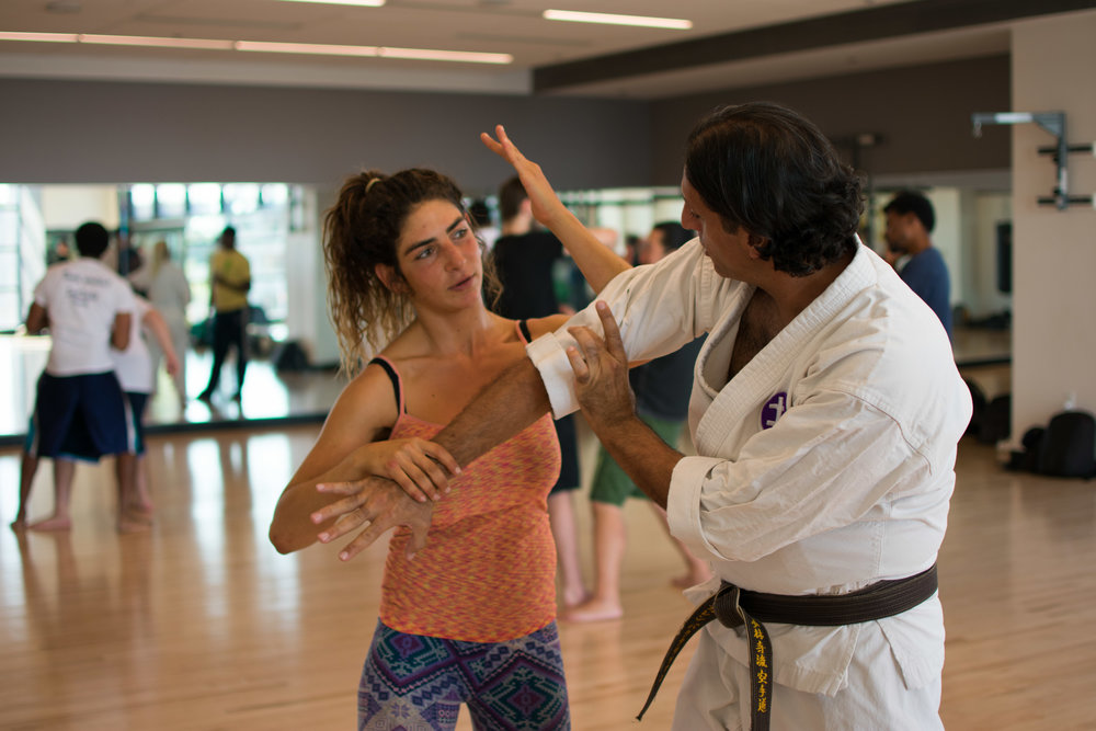 On September 26th, SMC Student Yael Sagi is shown how to execute a move by instructor Garen Baghdasarian who teaches a Karate class at Santa Monica College in Santa Monica, California. (Photo by Ethan Lauren)
