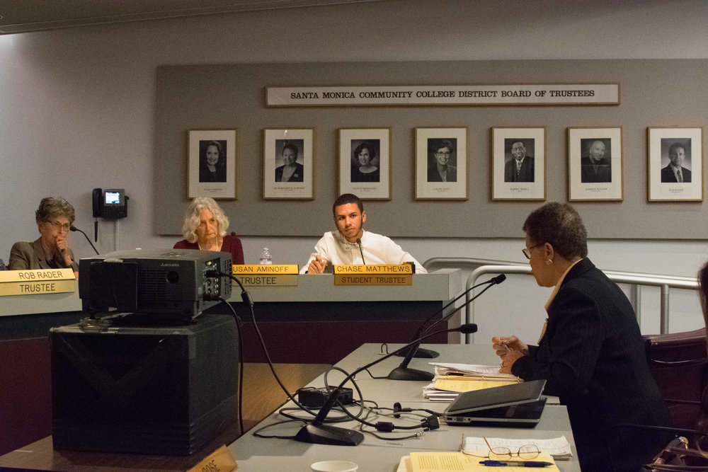 On October 3rd, Student Trustee Chase Matthews (center) discusses with the Vice President of Human Resources, Marcia Wade (right) on raising the minimum wage for student workers at Santa Monica College to be the same as the city of Santa Monica, California. The Board of Trustees meet once a month in the SMC Business Building, room 117. (Photo by Ethan Lauren)