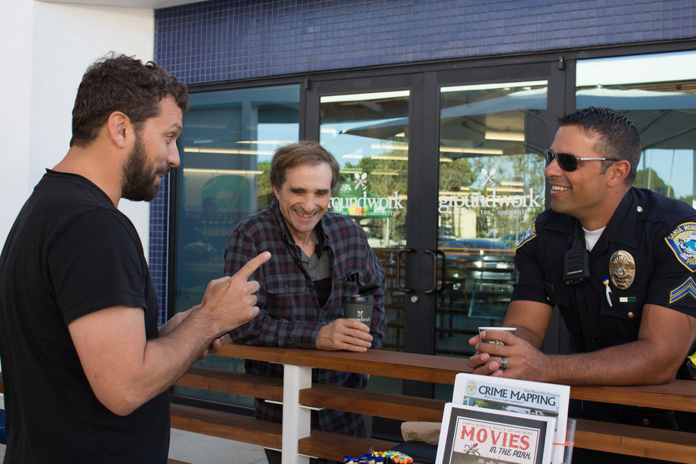Sam W. (left) Brad Pollack (center) and Officer Richard Verbeck (right) talk and laugh during National Coffee with a Cop Day on Wednesday, October 4, 2017, in front of Groundwork located in Santa Monica, Calif. The purpose of the event is to create an opportunity for the community and officers to communicate and bring them together. (Photo by: Brian Quiroz)