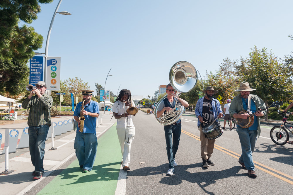 A group of musicians formed a small marching band to play music through the closed streets of Santa Monica during COAST and paraded along mainstreet playing songs. The second ever COAST was held in Santa Monica, Calif.. (Photo by: Justin Han/Corsair Staff)