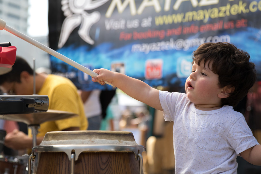 "Ofeck Sharon tries to play the drums after the performance of ""Mayaztek"". Their performance was one of many at the City of Santa Monica's Open Streets Festival (COAST) which took place on October 1, 2017. (Photo By: Zane Meyer-Thornton)"