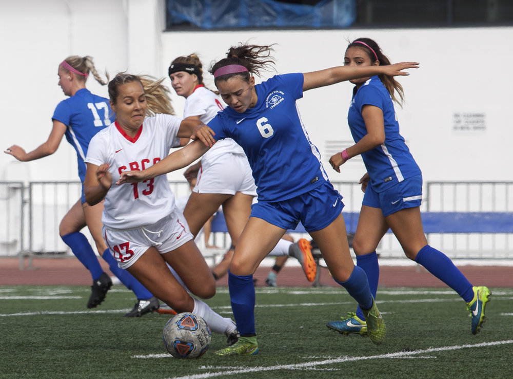 Santa Monica Corsair Paulina Salas (4)(right) attempts to gain possession of the ball from Santa Barbara Vaqueros Viana Isabella (11)(left) during a match on the Corsair Field at Field at Santa Monica College, Calif. on October 3rd, 2017. The Corsairs won 2-0.  Photo by: Elena Rybina