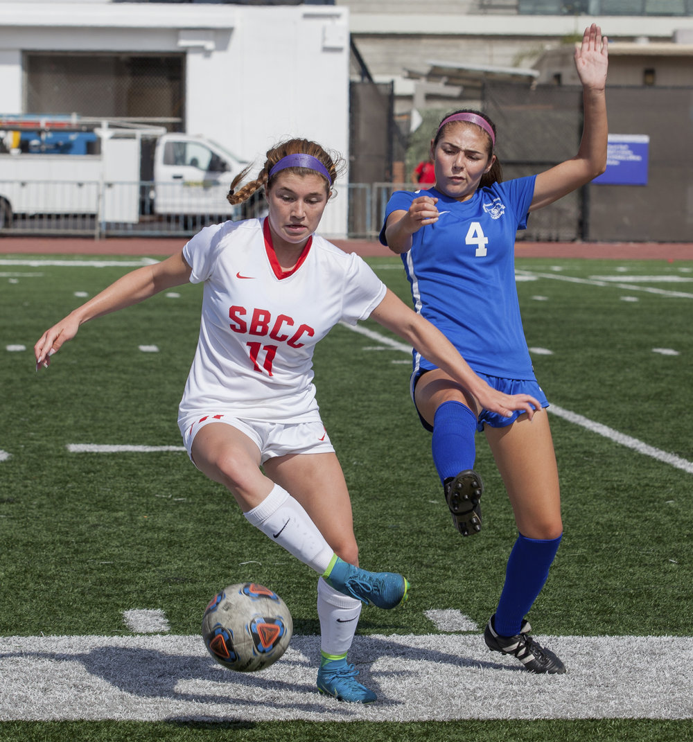 Santa Monica Corsair Antoinette Saldana (6)(right) fights for possession of the ball against Santa Barbara Vaqueros Amber Mulligan (13)(left) during a match on the Corsair Field at Field at Santa Monica College, Calif. on October 3rd, 2017. The Corsairs won 2-0.  Photo by: Elena Rybina