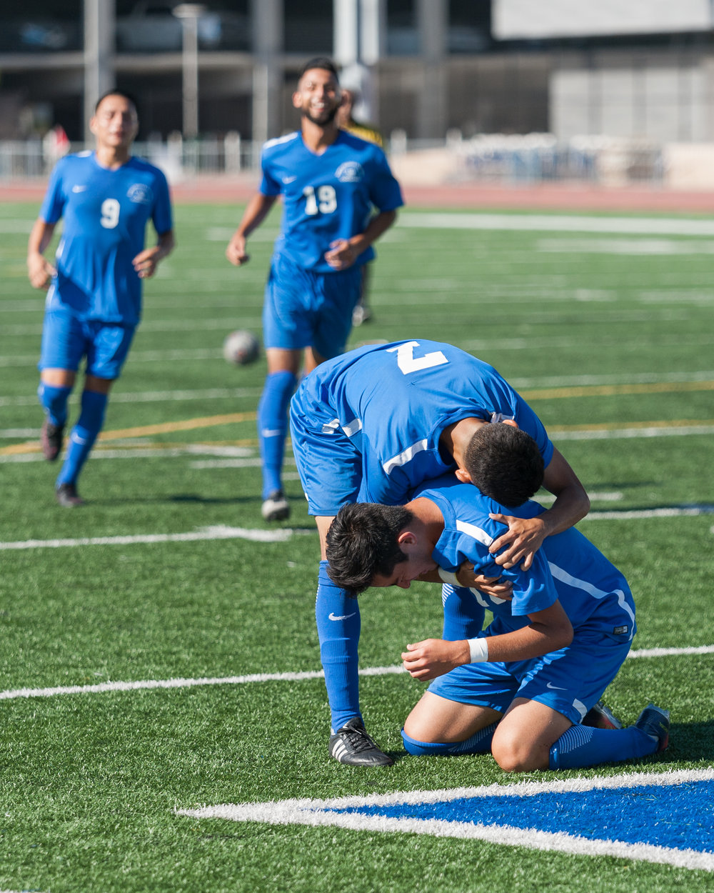 Midfielder Carlos Rincon (16) unleashes his emotions as he is embraced by teammate Kevin Martinez (7) who scored The Corsair's first goal in the a minute prior. Rincon scored the second goal, putting the Corsairs up 2-0 against Victor Valley at the 61st minute mark. The Santa Monica College Corsairs won the game 2-0 against the Victor Valley Rams. The match was held at the Corsair Stadium at Santa Monica College in Santa Monica, Calif. on October 6, 2017.  (Photo by: Justin Han/Corsair Staff)