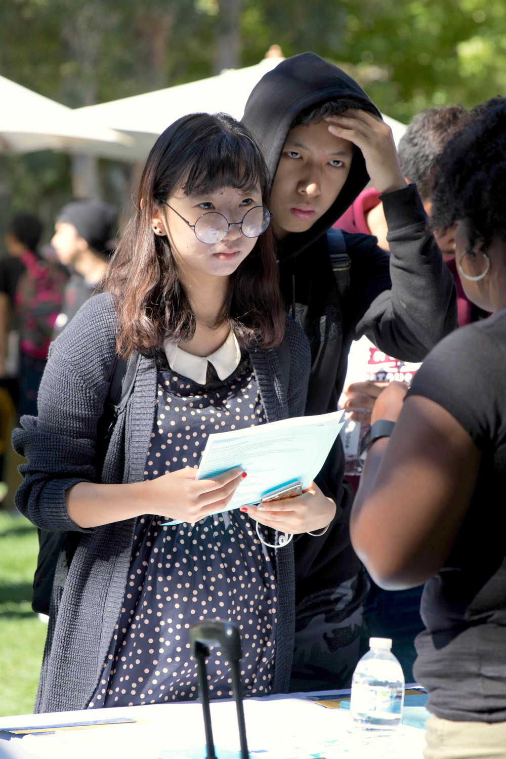 Alice Zhang (left) and Eric Zhang (right) gather information from one of the numerous California State Universities that were in attendance for Santa Monica Colleges Annual College Fair which took place on October 10 (Photo By: Zane Meyer-Thornton)