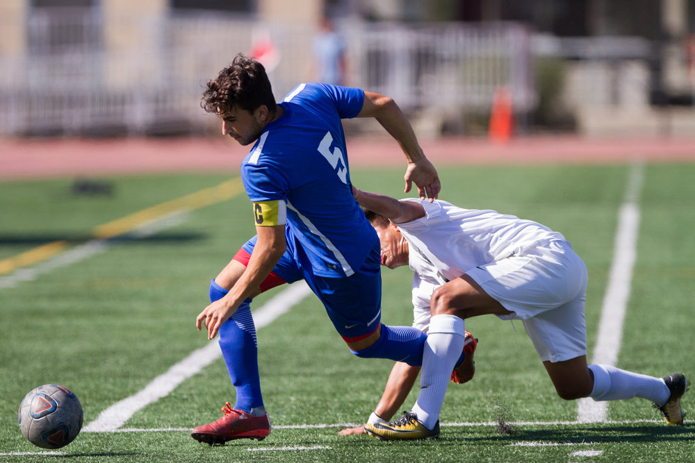 Santa Monica College Corsair Rudi Ibrahim (5) (L) fights for possession of the ball against Moorpark College Raider Cesar Ramirez (7) (R) on Tuesday, October 10, 2017, on the Corsair Field at Santa Monica College in Santa Monica, California. The Corsairs win the game 3-1. (Josue Martinez)