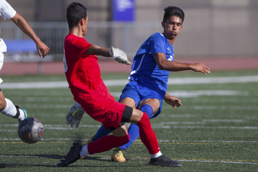 Santa Monica College Corsair Andy Naidu (8) (R) kicks the ball past Moorpark College Raider Kobi Vega (29) (L) and scores his second goal on Tuesday, October 10, 2017, on the Corsair Field at Santa Monica College in Santa Monica, California. The Corsairs win the game 3-1. (Josue Martinez)