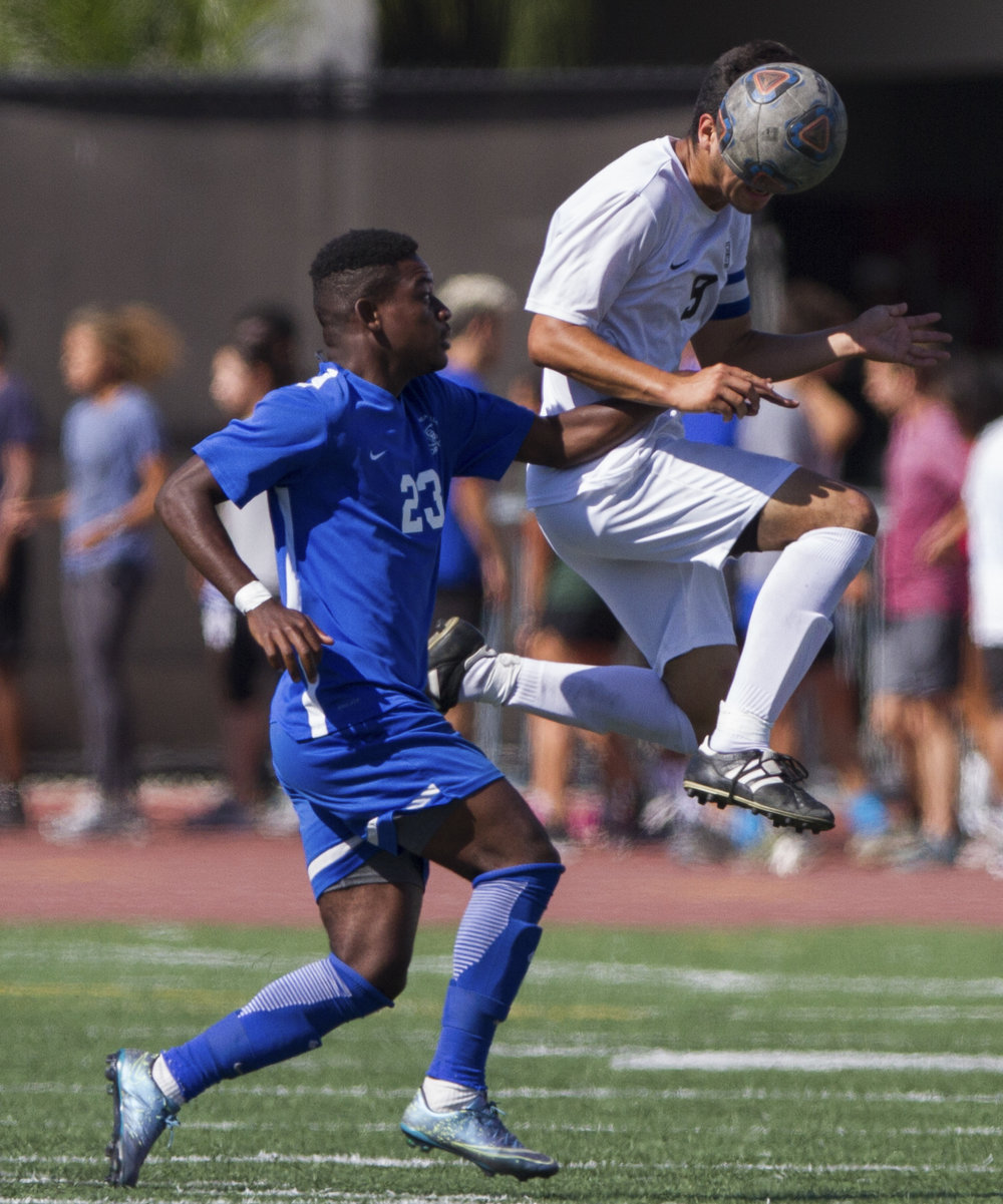Santa Monica College Corsair Divine Sumbu (23) (L) attempts to get possession of the ball against Moorpark College Raider Angel Perez (9) (R) on Tuesday, October 10, 2017, on the Corsair Field at Santa Monica College in Santa Monica, California. The Corsairs win the game 3-1. (Josue Martinez)
