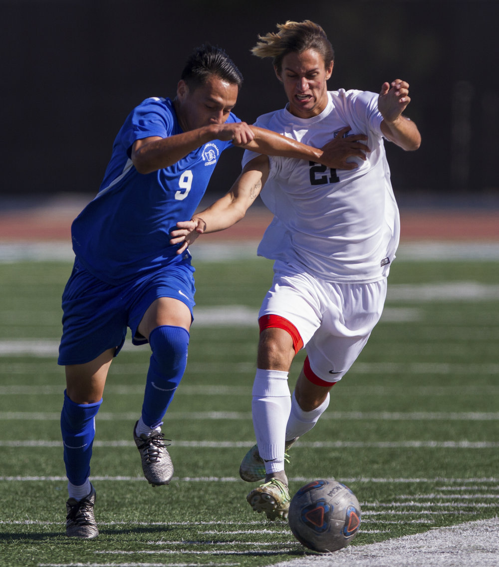 Santa Monica College Corsair Chris Negrete (9) (L) fights for possession of the ball against Moorpark College Raider Matthew Iannolo (21) (R) on Tuesday, October 10, 2017, on the Corsair Field at Santa Monica College in Santa Monica, California. The Corsairs win the game 3-1. (Josue Martinez)