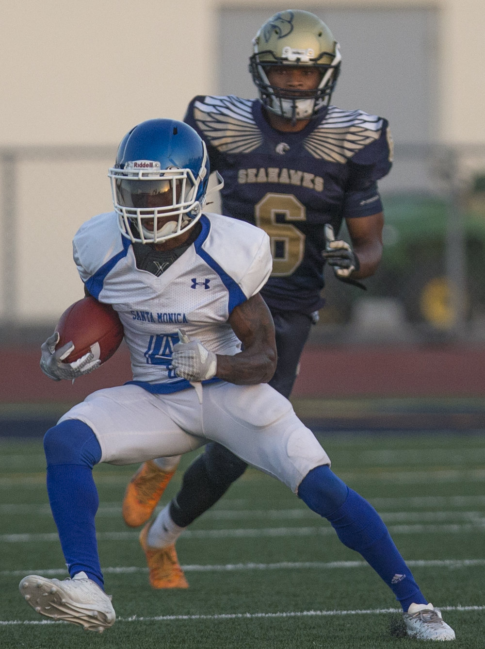 The Santa Monica College Corsairs Mens football wide reciever Christian Franklin (4) (white,center) beats a tackle by The LA Harbor College Seahawks Saturday, September 30th, 2017, at LA Harbor College in San Pedro, CA. The Corsairs loose to the Seahawks 28-21. (Daniel Bowyer/Corsair Staff)
