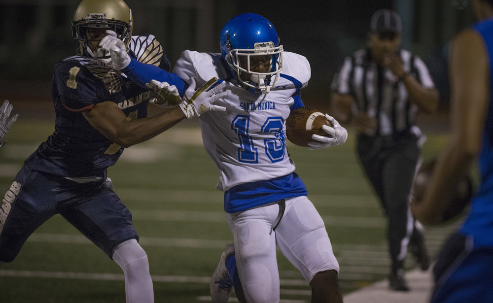 The Santa Monica College Corsairs Mens football wide reciever Elijah Brokin (13) (white,right) gets tackled out of bounds by The LA Harbor College Seahawks defensive back D'Andre Smart (1) (blue,left), Saturday, September 30th, 2017, at LA Harbor College in San Pedro, CA. The Corsairs loose to the Seahawks 28-21. (Daniel Bowyer/Corsair Staff)