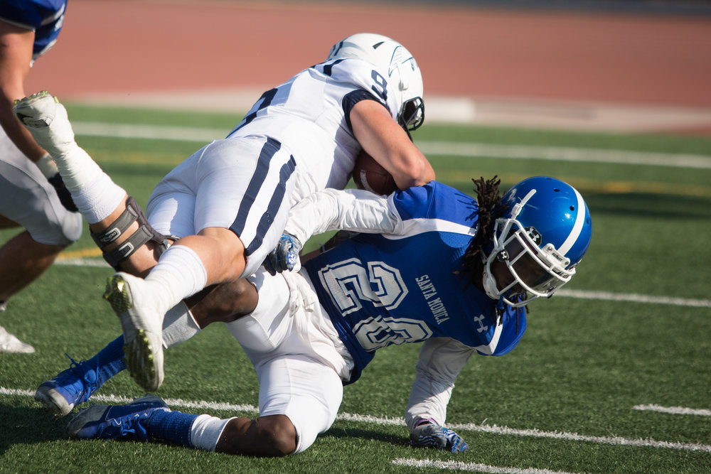 Difensive back Tyler Cater (20) of Santa Monica College attempt to stop Placekicker Fernando Buenabad (9) of Cerritos College. The Santa Monica College Corsairs lose the game 7-31 against Cerritos Falcons on Saturday, October 14th, 2017 at the Corsair Stadium at Santa Monica College in Santa Monica, California. (Photo by Yuki Iwamura)