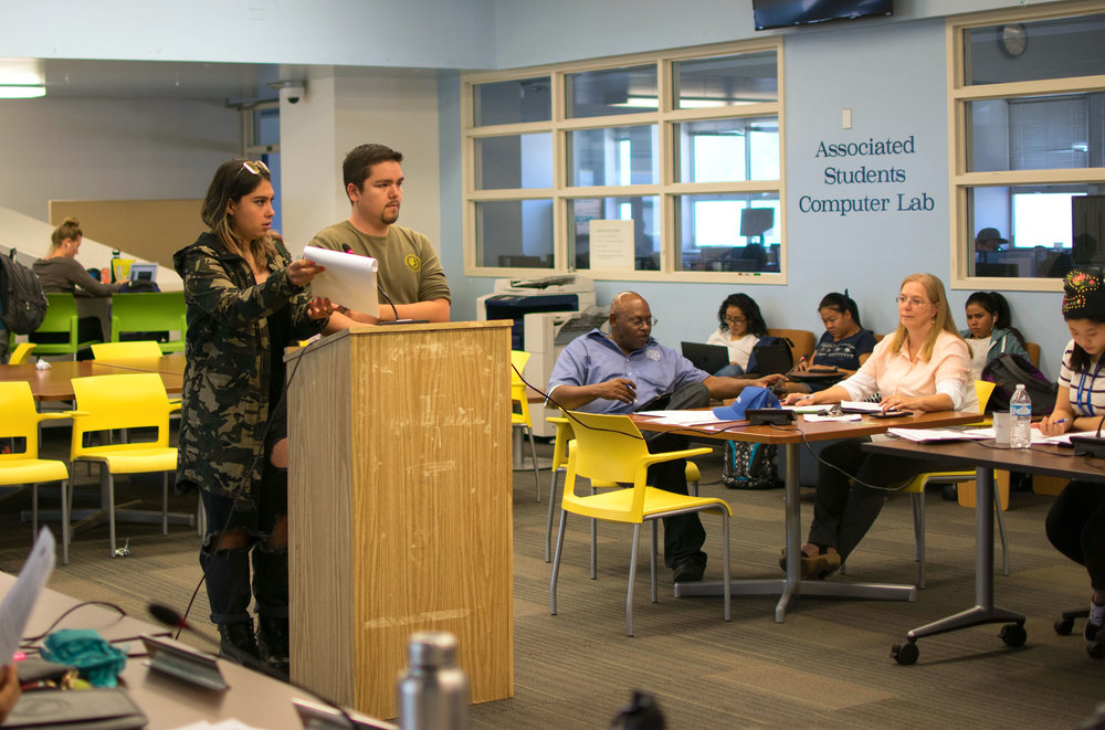 On October 9th, Diego Johansen, President of the Eco-Action Club on campus and Alexa Benavente, the Director of Sustainability for the Associated Students of Santa Monica College discuss their plans for the upcoming Sustainability Week. The A.S. hold weekly board meetings at 3 p.m. at the Cayton Center in Santa Monica, California. (Photo by Ethan Lauren)