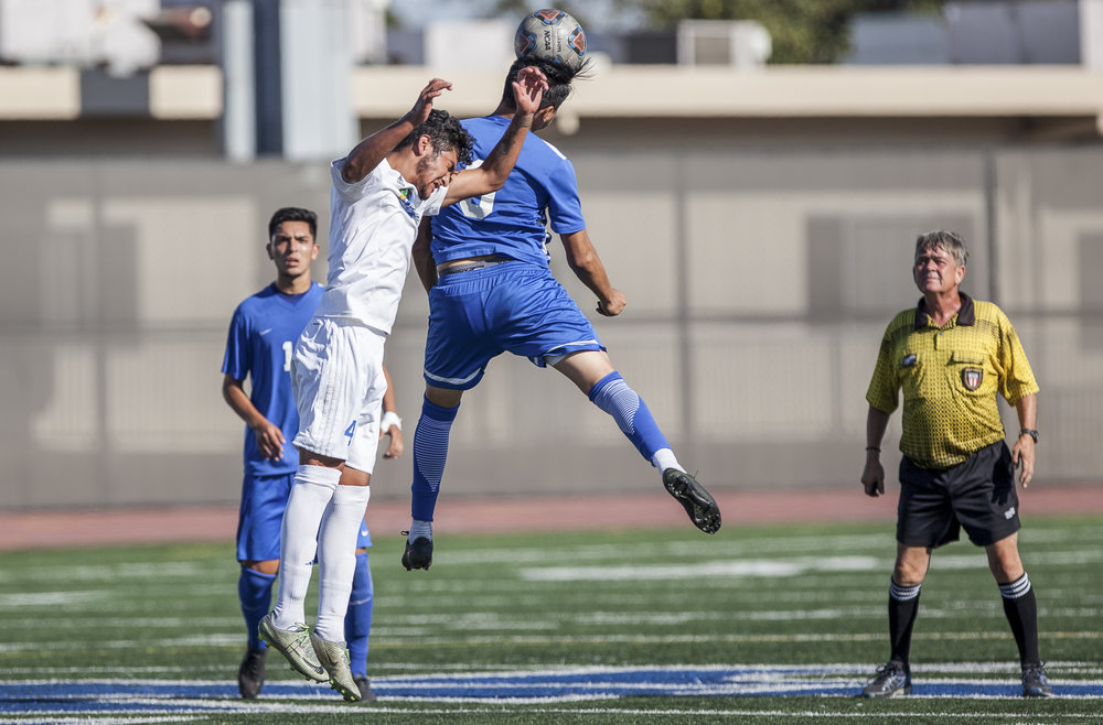 Chris Negrete (9) of the Santa Monica College  jumps up to perform the ball.  The Santa Monica College Corsairs won the game 2-0 against the Oxnard College. The match was held at the Corsair Stadium in Santa Monica, Calif. on October 17, 2017. (Photo: Elena Rybina)