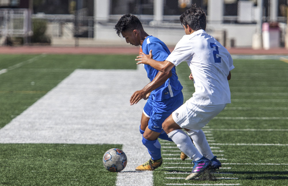 Andy Naidu (8) of the Santa Monica College protects the ball from Francisco Arroyo (2) of Oxnard College. On October 17, 2017 the Santa Monica College Corsairs won the game 2-0 against the Oxnard College. The match was held at the Corsair Stadium in Santa Monica, Calif. (Photo: Elena Rybina)