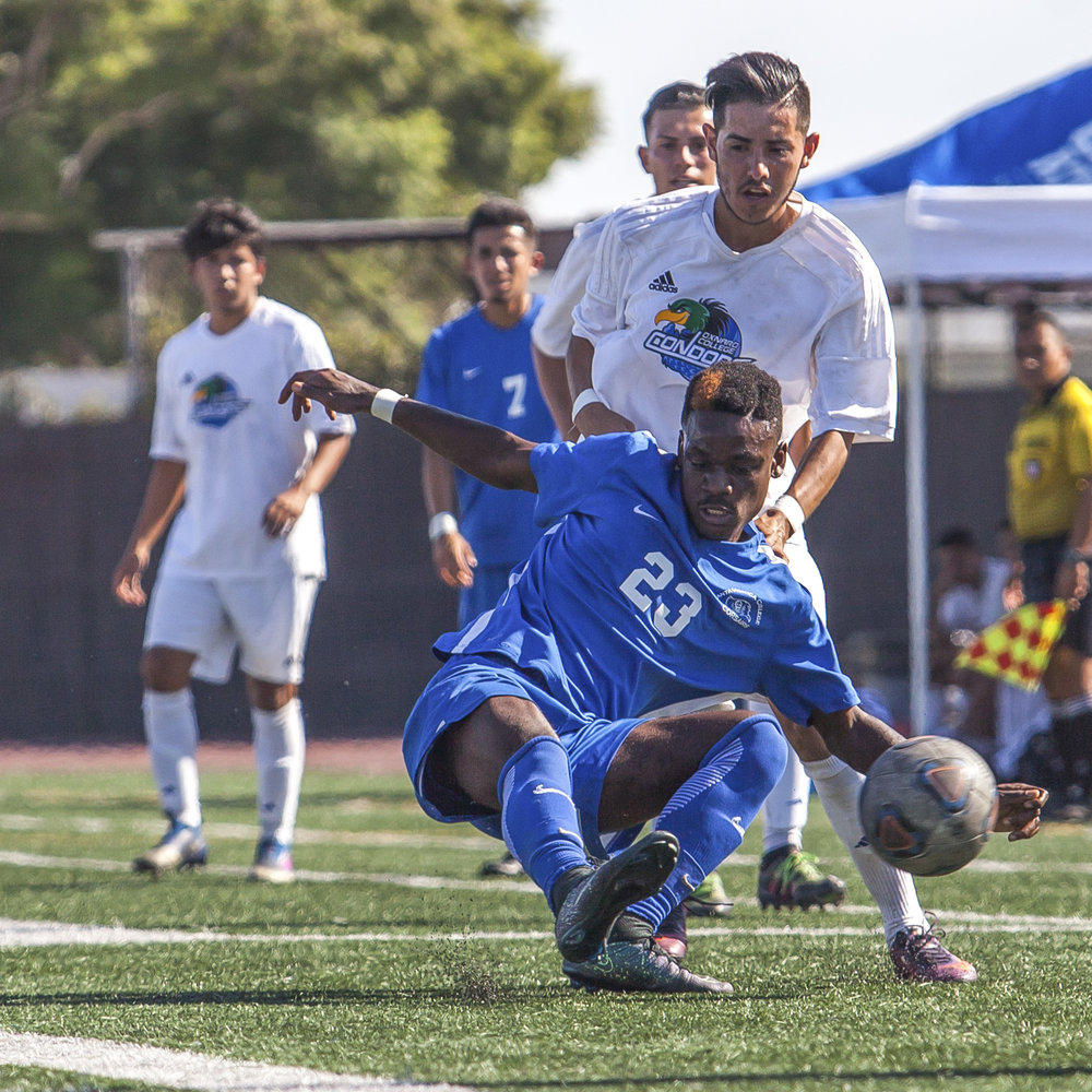 Divine Sumbu (23) of the Santa Monica College knocks out the ball from Luis Rivera (10) of Oxnard College.  On October 17, 2017 the Santa Monica College Corsairs won the game 2-0 against the Oxnard College. The match was held at the Corsair Stadium in Santa Monica, Calif. (Photo: Elena Rybina)