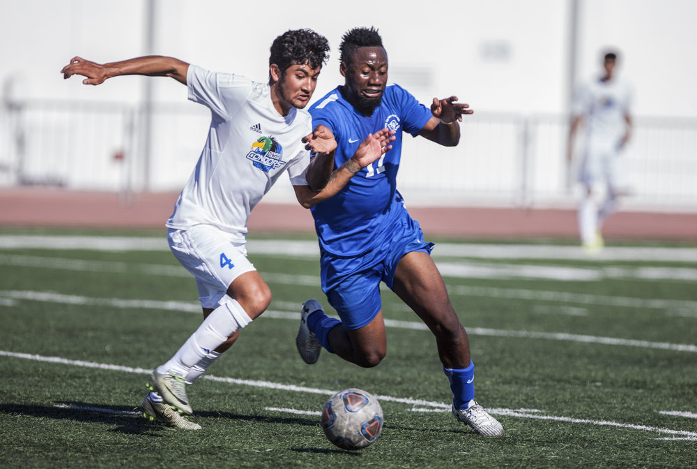 Cyrille Njomo (17) of the Santa Monica College tries to withdraw the ball from Benjamin Garcia (4) of Oxnard College. The Santa Monica College Corsairs won the game 2-0 against the Oxnard College. The match was held at the Corsair Stadium in Santa Monica, Calif. on October 17, 2017. (Photo: Elena Rybina)