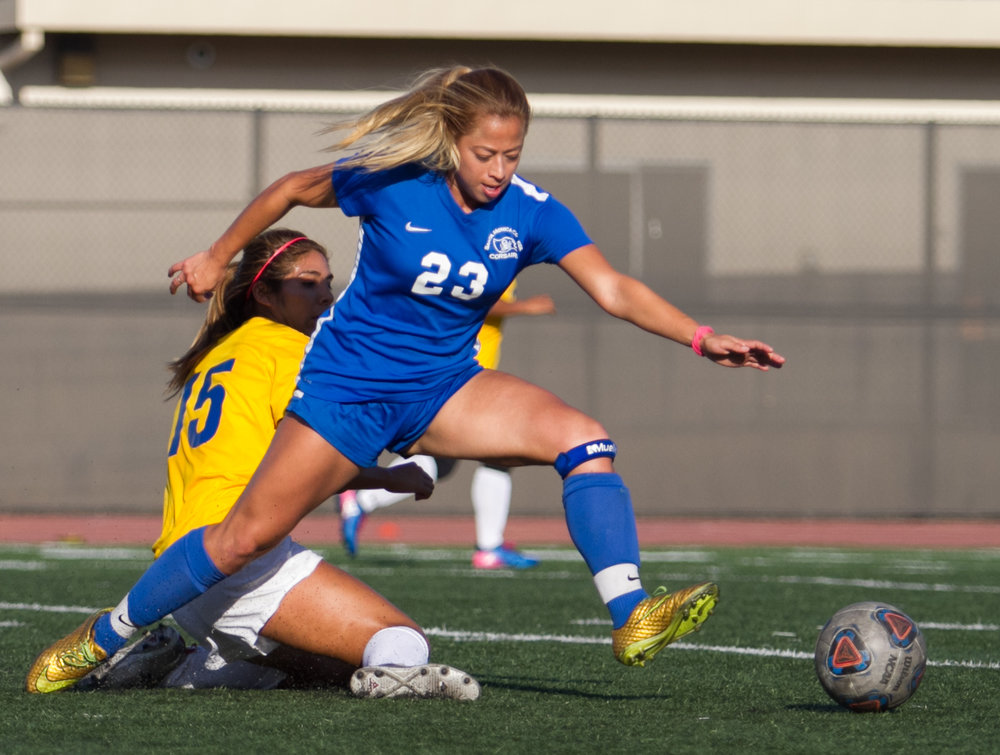 Santa Monica College Corsair Daysi Serrano (23)(R) fights for possession of the ball against West LA College Wildcat Vivian Yupanqui (15)(L) on Tuesday, October 17, 2017, on the Corsair Field at Santa Monica College in Santa Monica, California. The Corsairs win the game 8-0. (Josue Martinez)