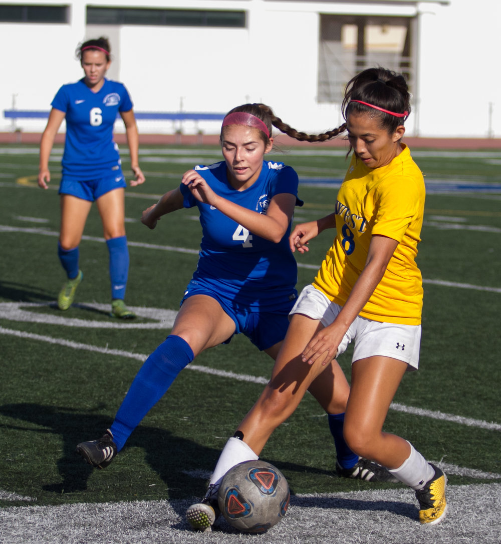 Santa Monica College Corsair Paulina Salas (4)(L) fights for possession of the ball against West LA College Wildcat Lincy Villatoro (8)(R) on Tuesday, October 17, 2017, on the Corsair Field at Santa Monica College in Santa Monica, California. The Corsairs win the game 8-0. (Josue Martinez)