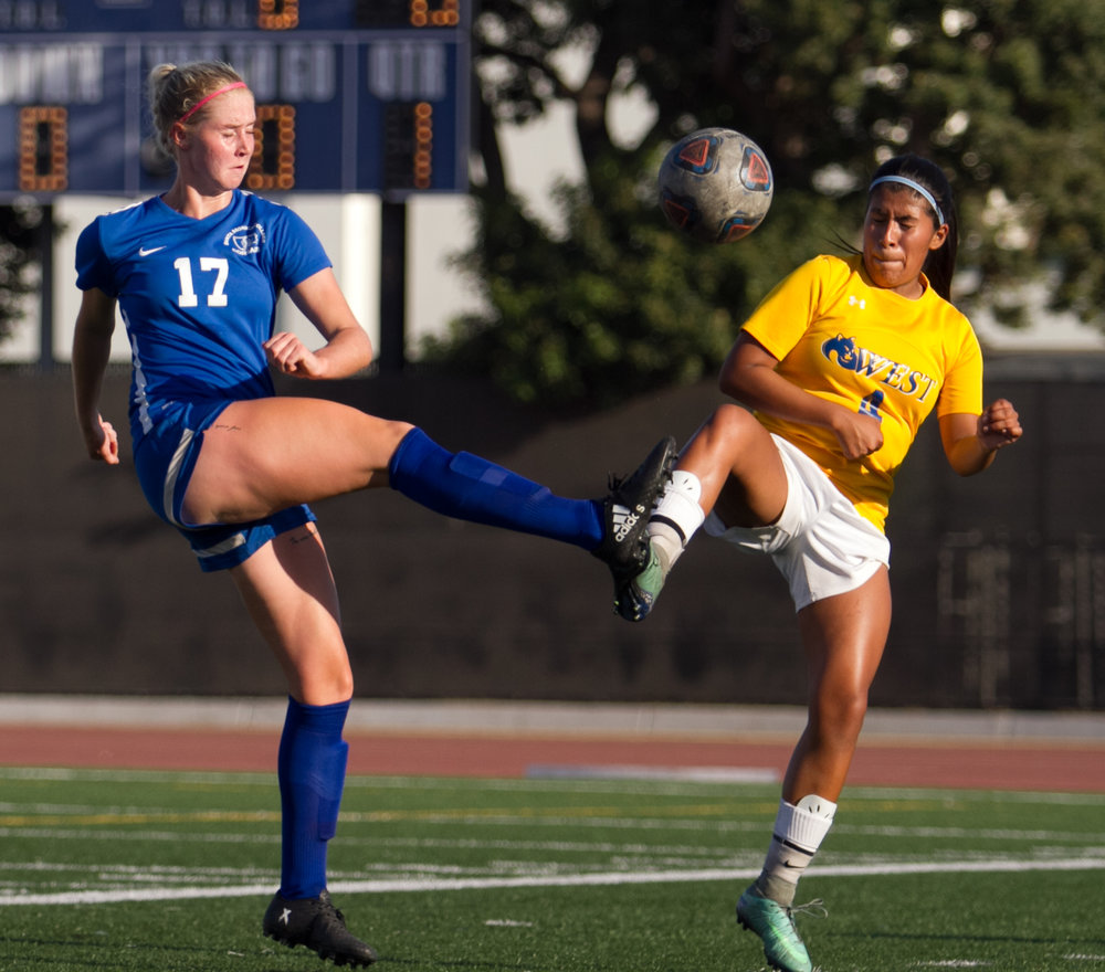 Santa Monica College Corsair Filippa Struxjo (17)(L) fights for possession of the ball against West LA College Wildcat Jocelyn Castillo (4)(R) on Tuesday, October 17, 2017, on the Corsair Field at Santa Monica College in Santa Monica, California. The Corsairs win the game 8-0. (Josue Martinez)