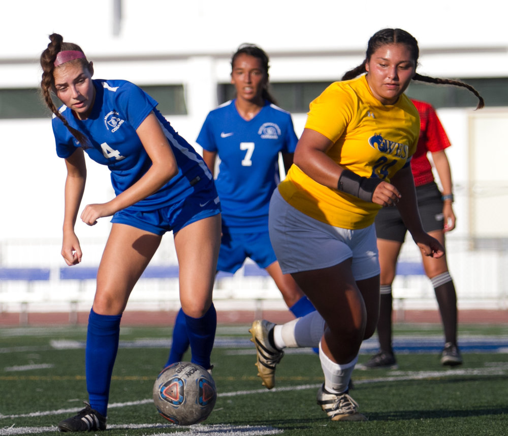 Santa Monica College Corsair Paulina Salas (4)(L) fights for possession of the ball against West LA College Wildcat Jaylene Navarro (24)(R) on Tuesday, October 17, 2017, on the Corsair Field at Santa Monica College in Santa Monica, California. The Corsairs win the game 8-0. (Josue Martinez)