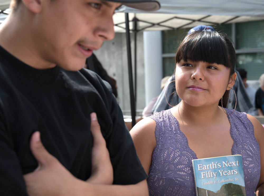 Vice president of Homeboys/Homegirls club, Salma Morales, (right) and club member, Benito Hernandes, at the book drive for youth in juvenile hall at Santa Monica College in Santa Monica, Calif. on October 19th, 2017. Photo by Willow Sando-McCall