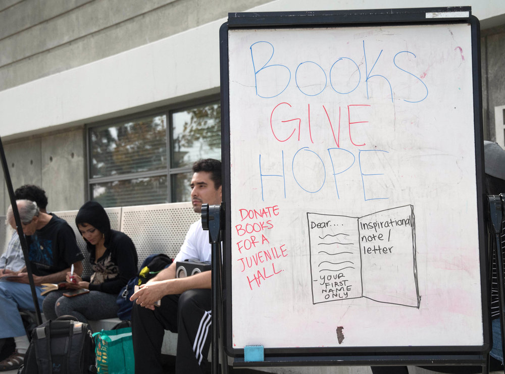 Book drive and letter writing for those in Juveille Hall hosted by Homeboy Industries at Santa Monica College in Santa Monica, Calif. on October 19, 2017. Photo by Willow Sando-McCall
