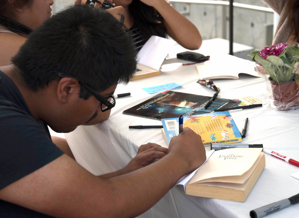 Students write letters in books to youth in juvenile hall for the book drive hosted by Homeboy Industries at Santa Monica College in Santa Monica, Calif. on October 19, 2017. Photo by Willow Sando-McCall