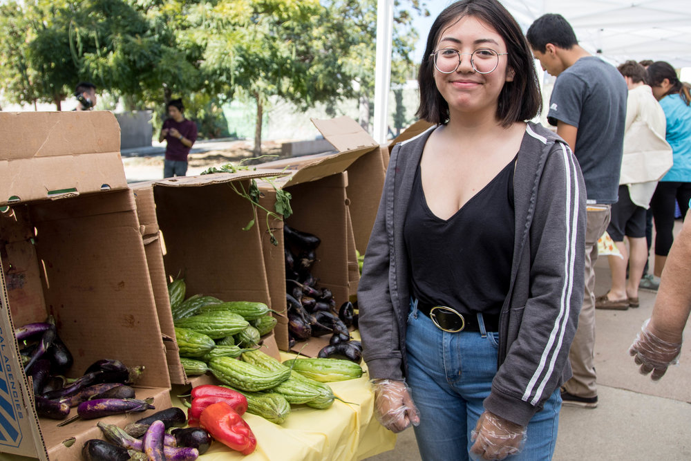 Nattalie Saravia, 18-year old Santa Monica College student and Glub Grow member, volunteers at the Free Corsair Market during Sustainability Week in Santa Monica, Calif. on October 16, 2017. (Photo: Jazz Shademan)