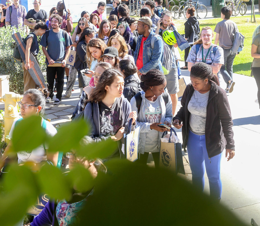 A long line of students wait near  the Organic Learning Garden for their free produce at 11 am that is put on by the Associated Students for Sustainability week at Santa Monica College's Main Campus in Santa Monica, Calif on Monday, October 16th 2017. (Photo by: Thane Fernandes)
