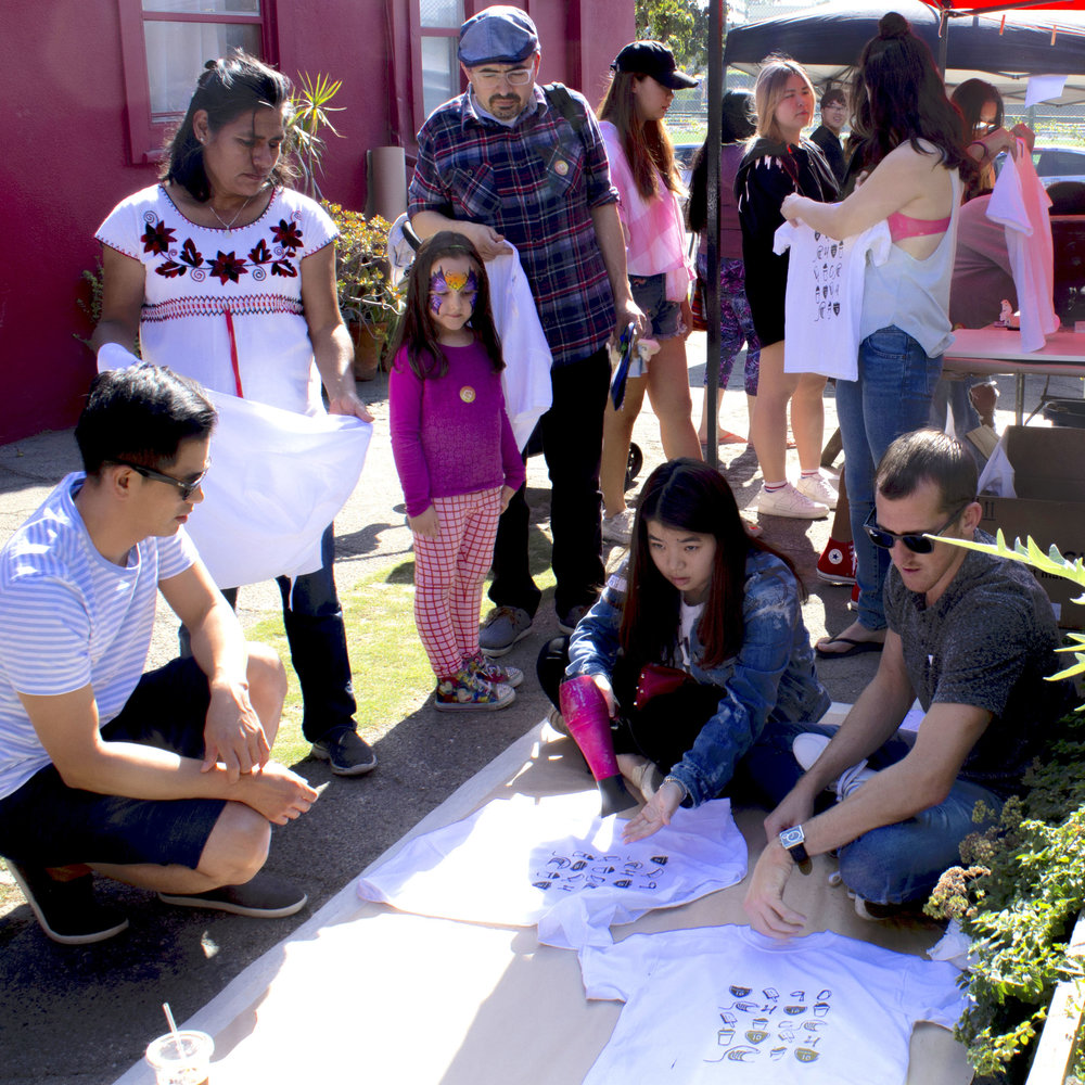 A small group of people gather around for the screen-Printing workshop at the Pico Block Party on October 14, 2017 in Santa Monica, Calif. (Photo By Emeline Moquillon)