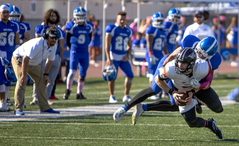 The Santa Monica College Corsairs Mens football linebacker D'Akibba Wallace (3) (blue,left) gets a sack against The Ventura College Pirates quarterback Ricky Town (8) (white,right) , Saturday, October 21st, 2017, at Santa Monica College in Santa Monica, Calif. The Corsairs loose to the Pirates 55-0. (Daniel Bowyer/Corsair Staff)