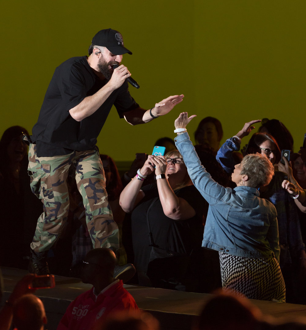 "Country singer Sam Hunt  sings ""House Party"" as he steps out on the second stage to high five a fan in the crowd at the Hollywood Bowl for CBS Radio's We Can Survive concert to raise money for breast cancer in Los Angeles, Calif on Saturday, October 21st 2017. (Photo by: Thane Fernandes)"