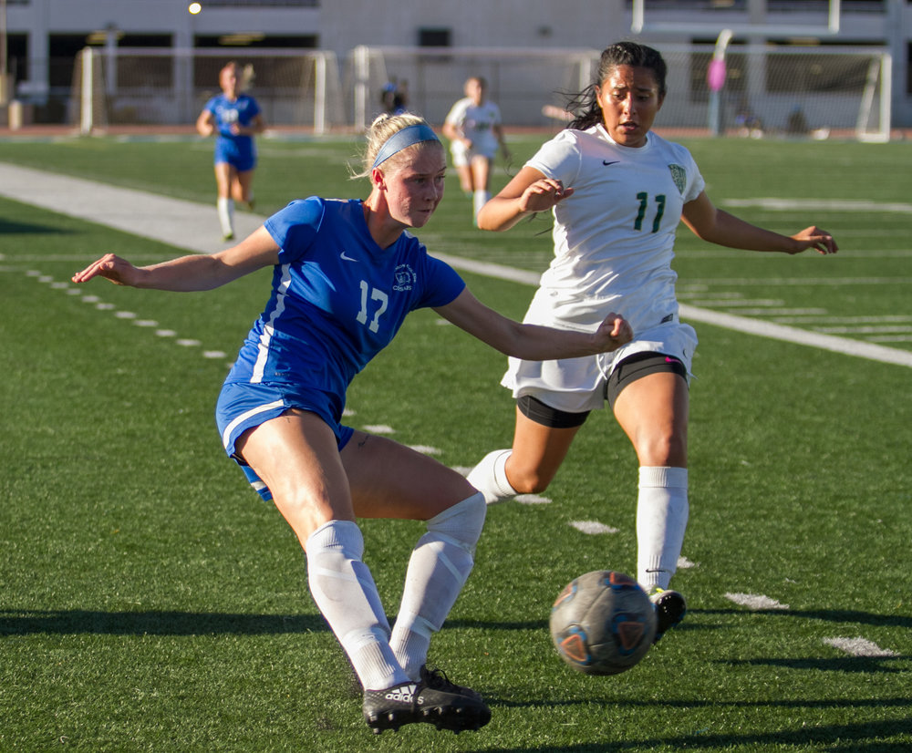 Santa Monica College Corsair Filippa Struxsjo (17)(L) attempts to center the ball while being pressured by LA Valley College Monarch Nathalia Campos (11)(R) on Tuesday, October 24, 2017, on the Corsair Field at Santa Monica College in Santa Monica, California. The Corsairs win the game 7-2. (Josue Martinez)