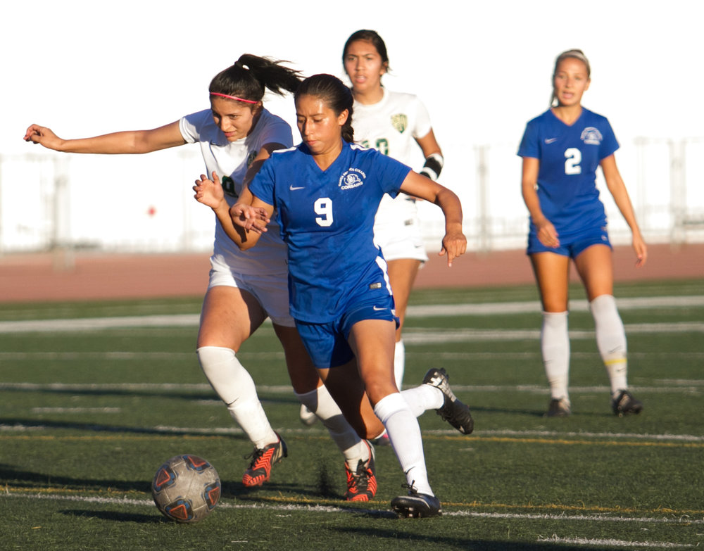 Santa Monica College Corsair Ashley Martinez (9)(R) fights for possession of the ball against LA Valley College Monarch Angie Aguirre (9)(L) on Tuesday, October 24, 2017, on the Corsair Field at Santa Monica College in Santa Monica, California. The Corsairs win the game 7-2. (Josue Martinez)