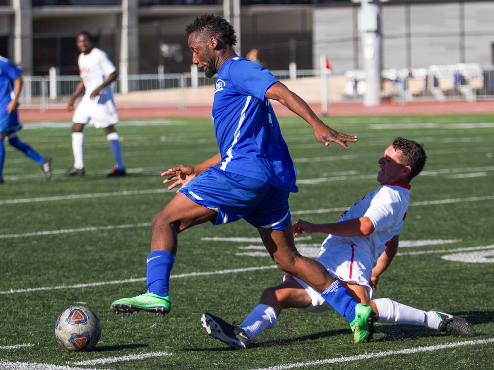 Santa Monica College Corsair Cyrille Njomo (17)(L) fights for possession of the ball  against Santa Barbara City College Vaquero Jessie Jimenez (8)(R) on Tuesday, October 24, 2017, on the Corsair Field at Santa Monica College in Santa Monica, California. The Corsairs tie 0-0. (Josue Martinez)