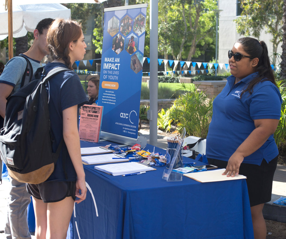 (L to R) Santa Monica College Freshman Ashley Haddad talks to ARC Human Resources Representative Jessica Palacios about ARC's mentoring program at the Job Fair at Santa Monica College's Main Campus in Santa Monica, Calif., October 24, 2017. (Photo By: Ripsime Avetisyan/Corsair Staff)