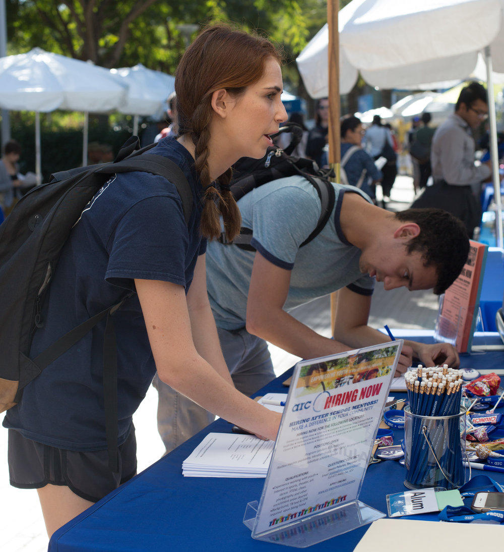 (L to R) Santa Monica College Freshman Ashley Haddad and Communications Major Tomas Bukakis sign up to get more info about ARC's mentoring program at the Job Fair at Santa Monica College's Main Campus in Santa Monica, Calif., October 24, 2017. (Photo By: Ripsime Avetisyan/Corsair Staff)