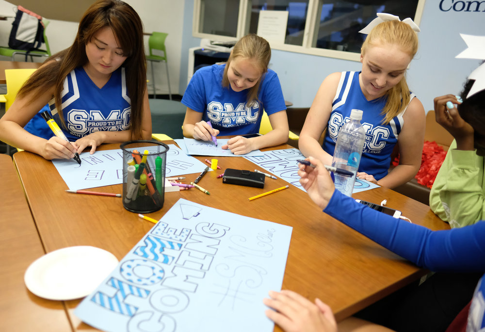 The Santa Monica Cheerleading team creating posters with Homecoming in mind for the poster contest during the Monday Night Football event for Spirit Week in Santa Monica College in Santa Monica, CALIF on October 30, 2017. (Photo by Jayrol San Jose)