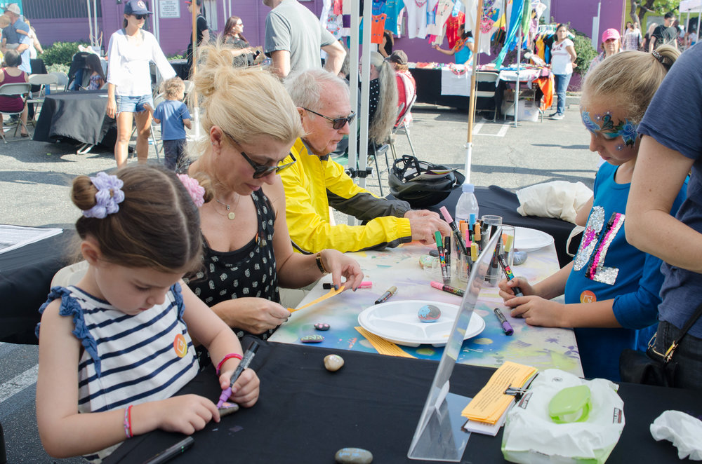 Pico Block Party participants painti on rocks for the Santa Monica Rocks, a treasure hunt project by Ten Women Gallery in the city of Santa Monica. October 14, 2017. Santa Monica, Calif. (Photo by: Diana Parra Garcia)