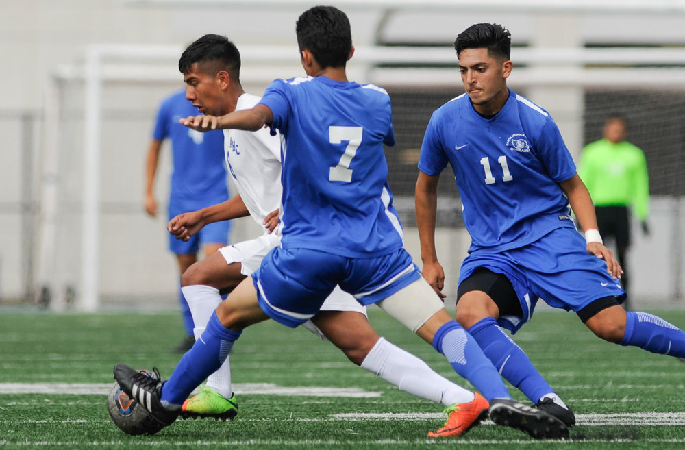 Midfielder Danny Hernandez (11,Right) and Kevin Martinez (7,Middle) of Santa Monica College attempt to contest midfielder Francisco Ayala (6,Left) of Allan Hancock College. The Santa Monica College Corsairs end the game tied with the Allan Hancock College Bulldogs 1-1. The match was held at the Corsair Stadium at the Santa Monica College Main Campus in Santa Monica, Calif.. October 31, 2017. (Photo by: Justin Han/Corsair Staff)