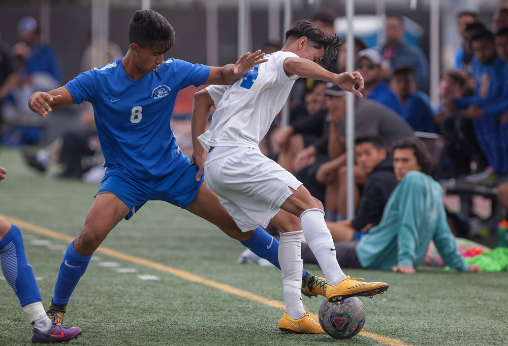 Andy Naidu (8) of the Santa Monica College to withdraw the ball from Eric Pulido (14) of the  Allan Hancock College. The game ended 1-1 resulting in a tie. The game was held at the Corsair Stadium at the Santa Monica College Main Campus in Santa Monica, California, on 31st of October, 2017. (Photo by: Elena Rybina)